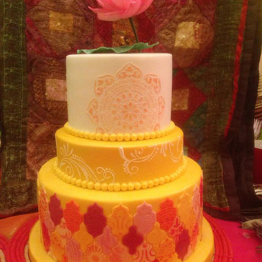 3 tier celebration cake with Moroccan tile effect, stencilled details and sugar lotus flower