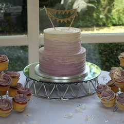 2 tier lavender ombre buttercream wedding cake with matching cupcakes