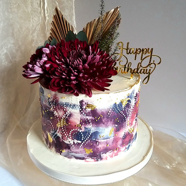 Buttercream birthday cake with watercolour effect, stencil detail, fresh flowers