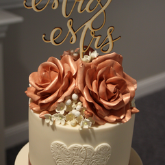 Rose gold sugar roses and filler flowers with laser cut Mr & Mrs topper