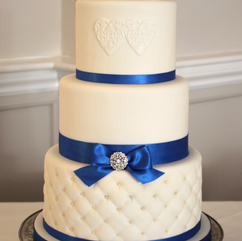 3 tier wedding cake with quilted effect, embossed hearts, diamante brooch and lego topper