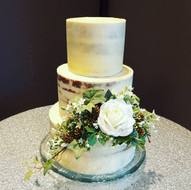 Semi-naked wedding cake with artifical flower decoration