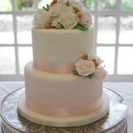 White and pale pink wedding cake