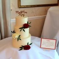 Buttercream wedding cake with fresh roses
