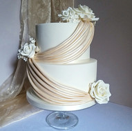 Champagne gold drapes wedding cake