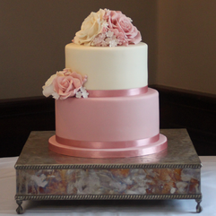 Two tier wedding cake with pink and ivory sugar roses