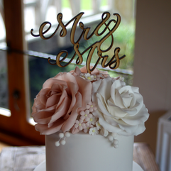 Ivory and pale dusky pink sugar roses and Mr & Mrs topper