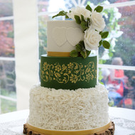 Forest green and gold wedding cake