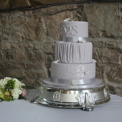 3 tier wedding cake with stencilled design, fondant ruffles and sugar butterflies