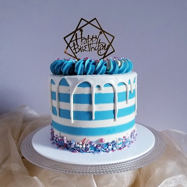 Buttercream stripes birthday cake with white chocolate drip