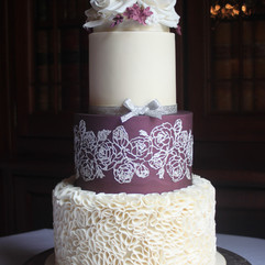 3 tier wedding cake with fondant ruffles, edible cake lace and ivory sugar roses.