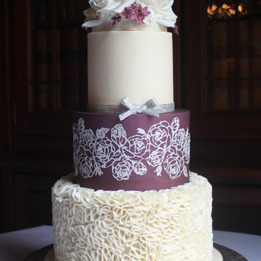 Ivory, plum and silver wedding cake