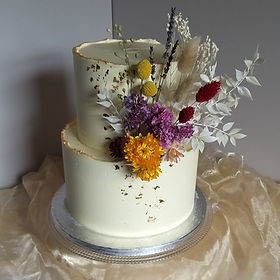 Buttercream cake decorated with dried flowers