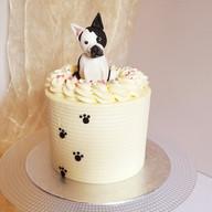 Buttercream birthday cake with fondant dog figure