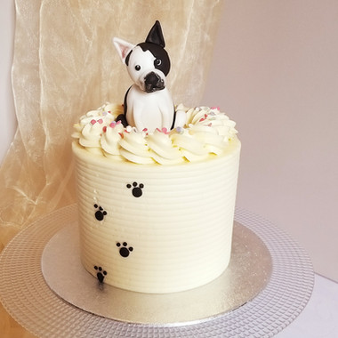 Buttercream birthday cake with fondant dog figure