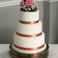 White and rose gold wedding cake