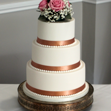 White and rose gold wedding cake