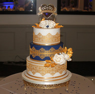 Blue and gold wedding cake