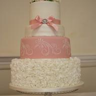 White and dusky pink wedding cake
