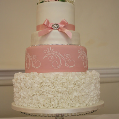 White and dusky pink wedding cake