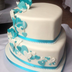 2 tier heart shaped wedding cake with turquoise fondant hearts