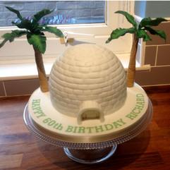 Igloo and palm trees birthday cake.
