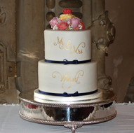 White and navy blue wedding cake