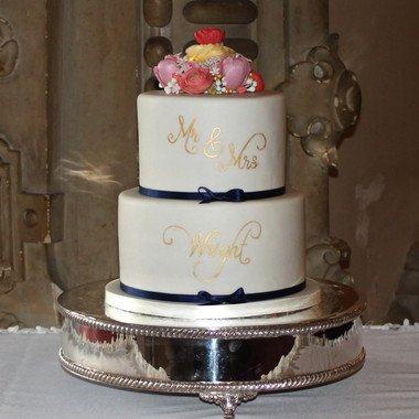 White and navy blue wedding cake