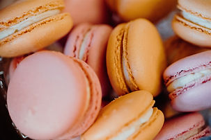 Pink and orange macarons for a dessert table.