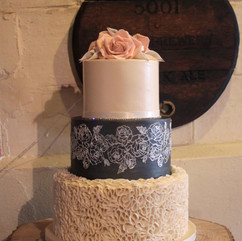 3 tier wedding cake with fondant ruffles, edible cake lace, sugar roses and calla lilies