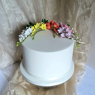 Fondant birthday cake with freeshias