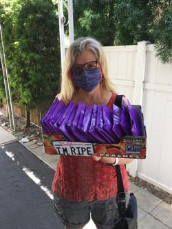 Founder Tiffany Herbert sending packages of masks & caps!