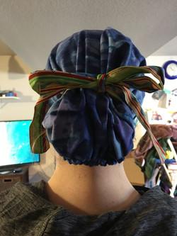 A long hair scrub cap sewn by volunteer Martha in CO!