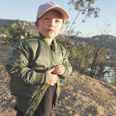 little boy in a dad hat