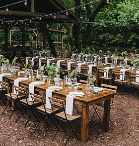 long+farmhouse+tables+with+greenery+budv