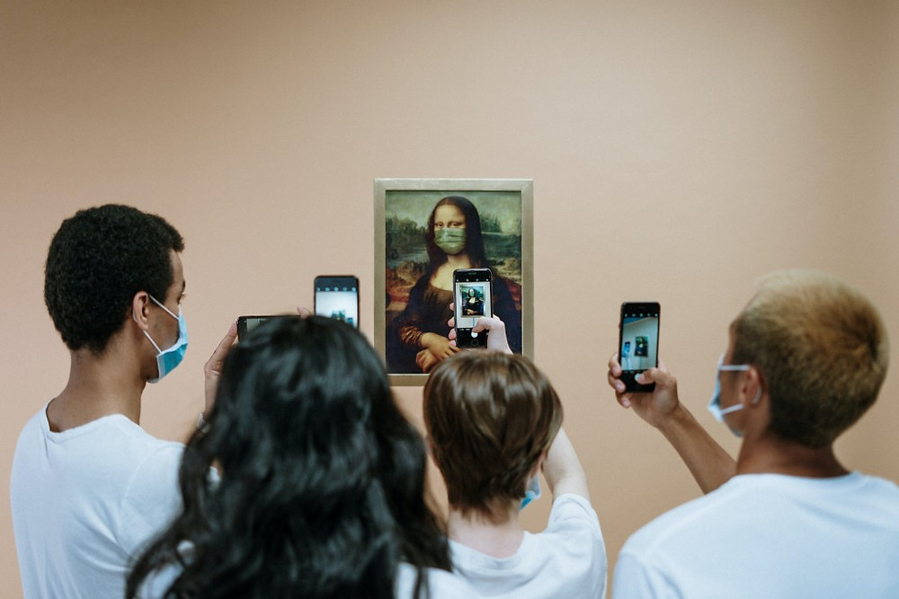 people-taking-picture-of-a-painting-of-mona-lisa-with-face-3957980