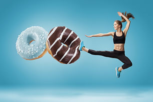 Fit-young-woman-fighting-off-bad-food-on