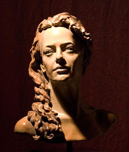 Self-portrait in bronze by S. Jacqueline Nicolini.