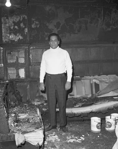 George Berry in his burned down pub, photographed by Neil Kenlock