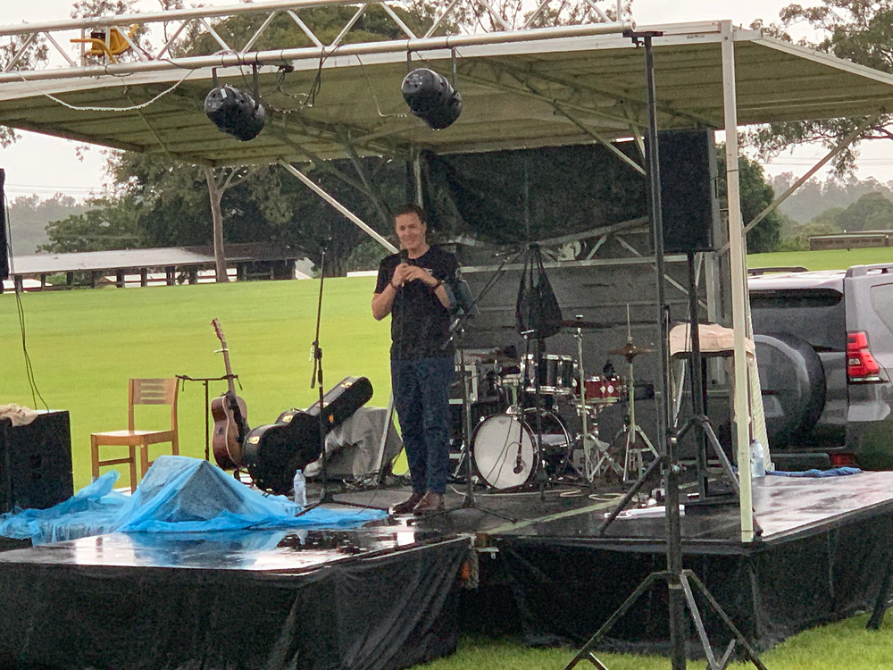 Ben preaching in the rain