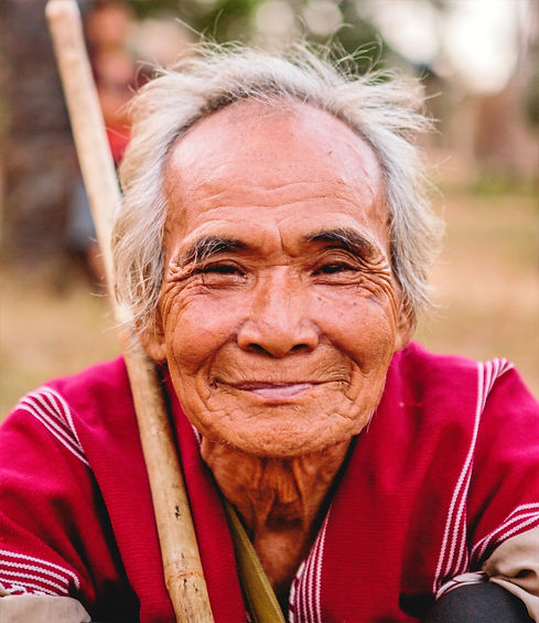 A portrait of an elder in a farming village in Myanmar. Photo by capturing the human spirit on unsplash.com