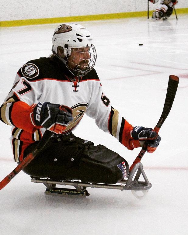 Brandon playing sled hockey.