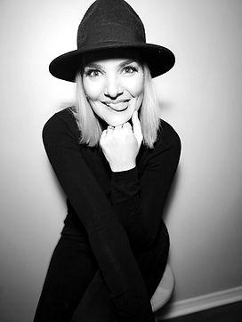 poet, writer, feminist, female, artist, female artist, black and white, black hat, goofy , black