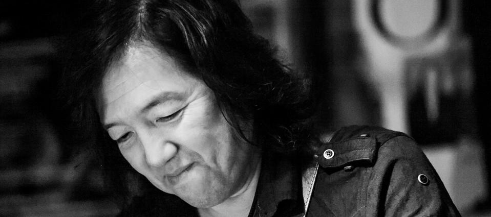 Toshi Yanagi on Guitar