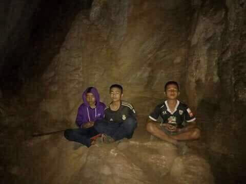The boys in the cave meditating while they wait to be rescued.