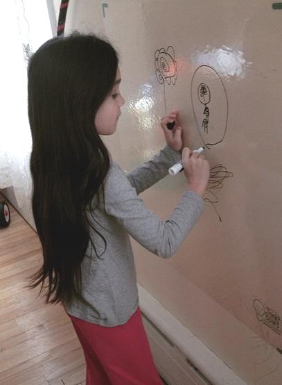 Girl writing on wall