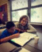 Tutor helping boy with homework