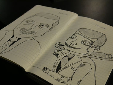 A journal with two portrait drawings