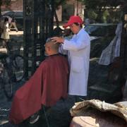 Sidewalk haircuts.  Beijing.