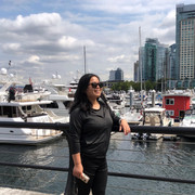 Fasionable woman and view at Coal Harbour, Vancouver.